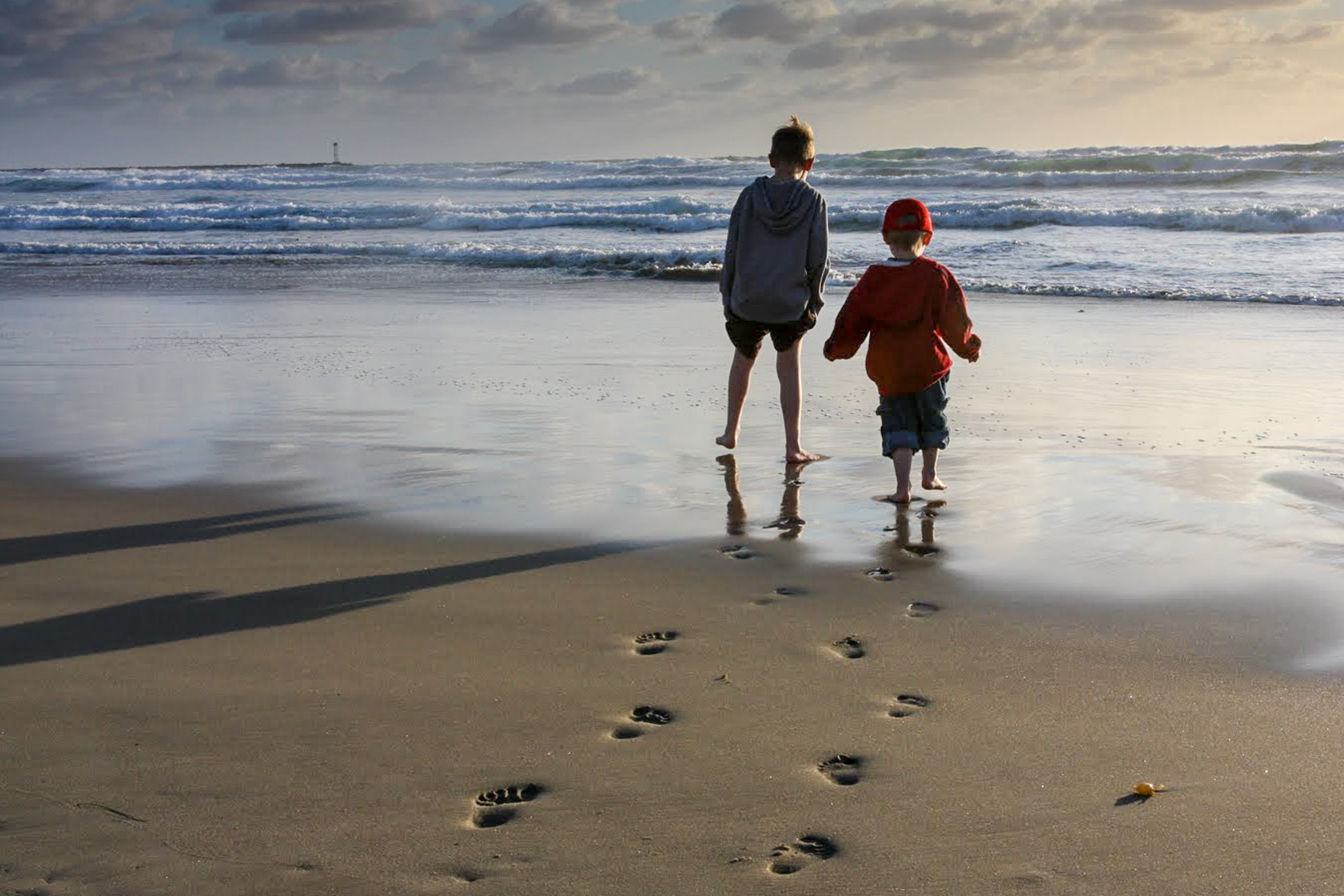 Footprints in the sand. Kids at the beach. San Diego, California